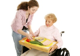 lady giving food to elder woman